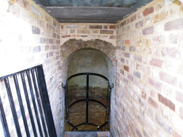 Photo of brick-lined entrance passage to the ice house.